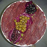 Platter of sliced SUPRI and Olives